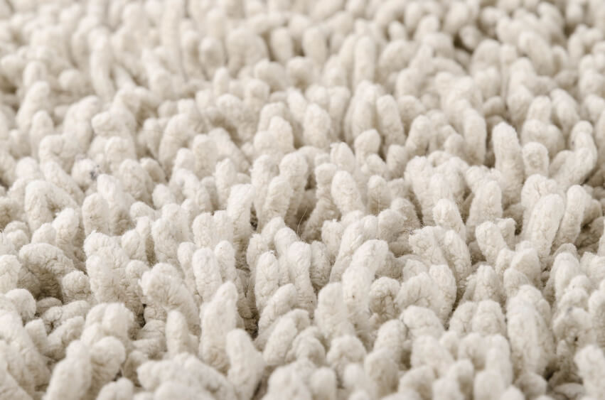 Close up of a white fluffy new and clean carpet.