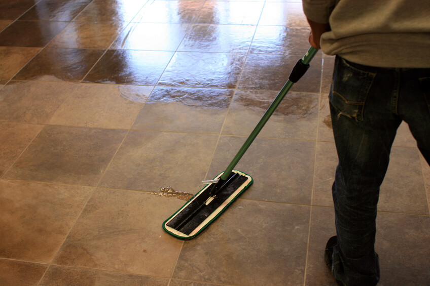 A man mopping a tile floor on a sunny day.  [url=/file_search.php?action=file&lightboxID=7669140&refnum=jitalia17] [img]http://www.johnwdefeo.com/Istock-Banners/On-the-Job.jpg[/img][/url]