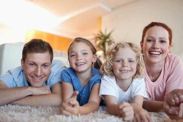 Image of a happy family after taking advantage of carpet cleaning in Provo UT